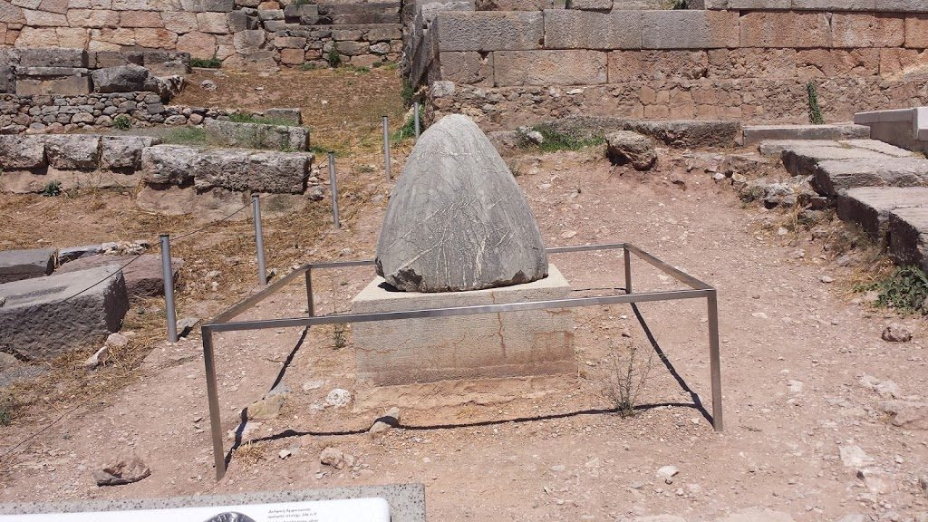"""The Omphalos of Delphi. In ancient times, Delphi was considered to be the center or """"navel"""" of the world. The Omphalus was a stone thrown by Zeus to mark the spot."""