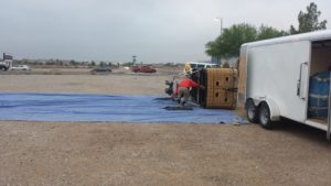 Unloading the balloon and its basket from the trailer